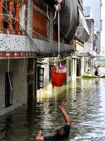 چین را آب برد؛ ۷نفر کشته شدند ۱۸نفر مفقود +عکس