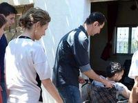 بشار اسد و همسرش در دیدار زخمی شدگان ارتش +عکس