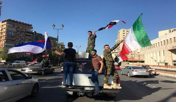 برافراشته شدن پرچم ایران توسط مردم سوریه +فیلم