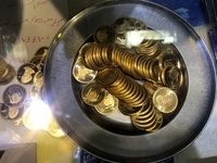 ریزش قیمت طلا و دلار در اولین روز هفته