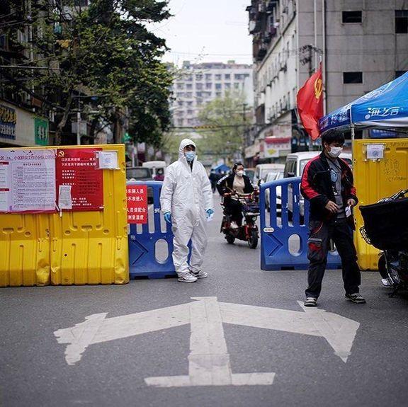 ادامه مقابله با کرونا در ووهان چین +تصاویر