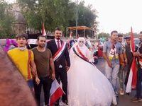 عروس و داماد عراقی در میدان التحریر بغداد +عکس