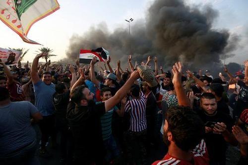 18کشته در اعتراضات عراق +عکس