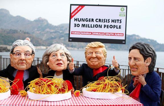 اعتراض به شیوع گرسنگی در جهان (کایکاتور)