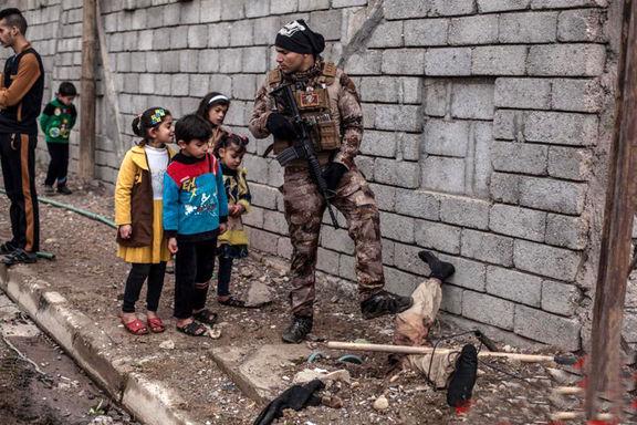 دیدن جسد داعشیها سرگرمی کودکان عراقی +عکس
