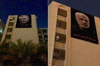 تصاویر شهیدان «سلیمانی» و «ابومهدی» بر ساختمان مقابل سفارت آمریکا