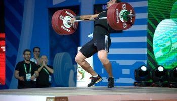 قهرمان وزنهبرداری جهان درگیرمصدومیت