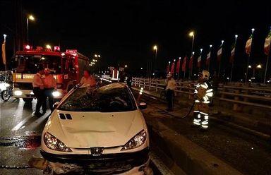 واژگونی پژو۲۰۶ در بزرگراه بعثت +عکس